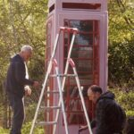 Traditional red phonebox being rennovated