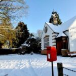Village Hall in winter, surrounded by snow